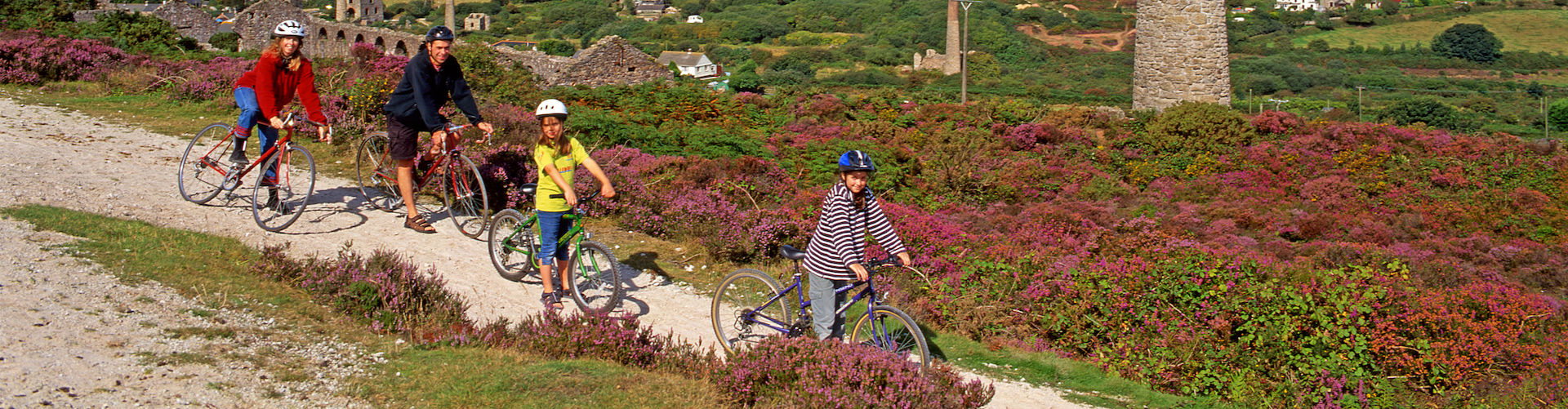 A family ride their bikes on the Mineral Tramway in Cornwall.
