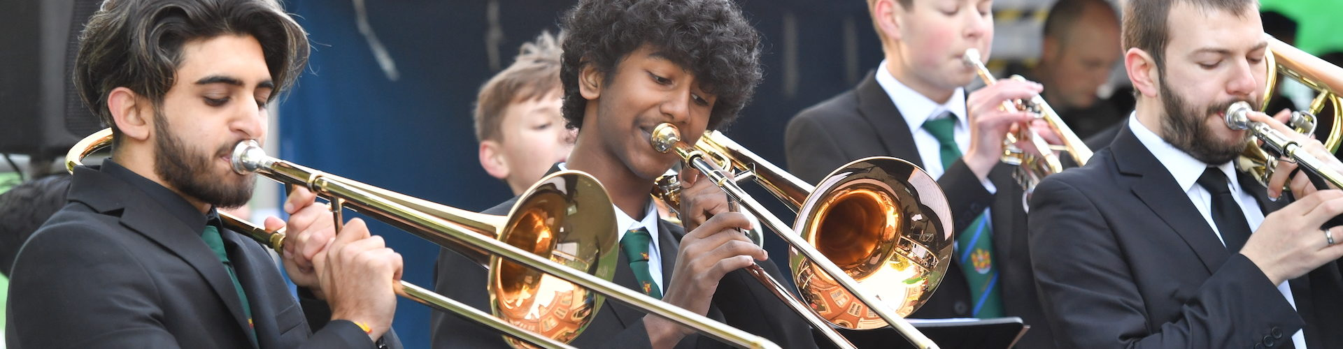 School children play brass instruments during the Tour of Britain.